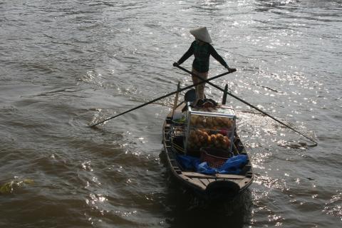 Marktfrau auf den Mekong Delta