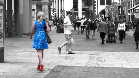 Lady in blue with red shoe