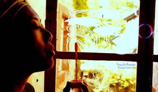 Blowing bubbles at the Window