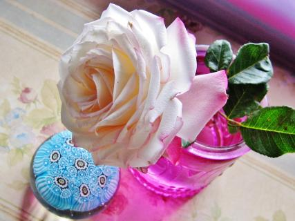 rose with paperweight