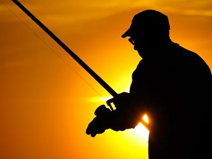 Fischer im Sonnenuntergang