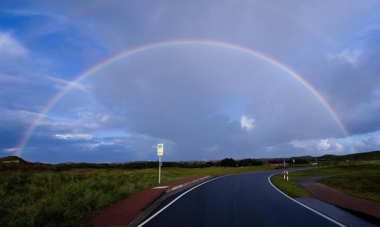 Rainbow over street